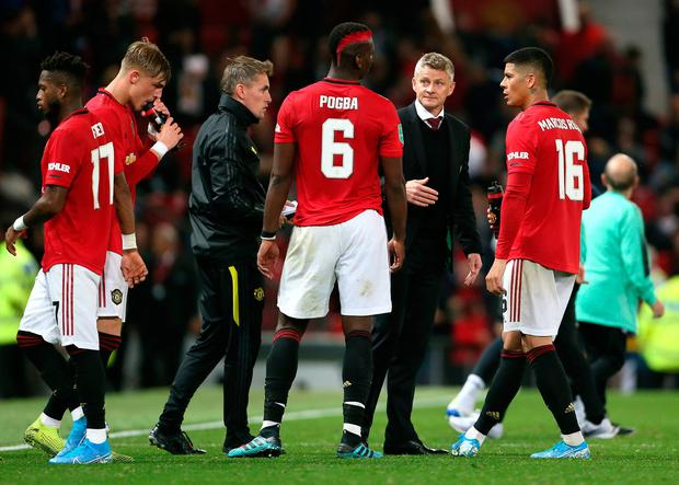 PRESSURE MOUNTS: Ole Gunnar Solskjaer talks to Paul Pogba during the match against Rochdale. Photo: PA