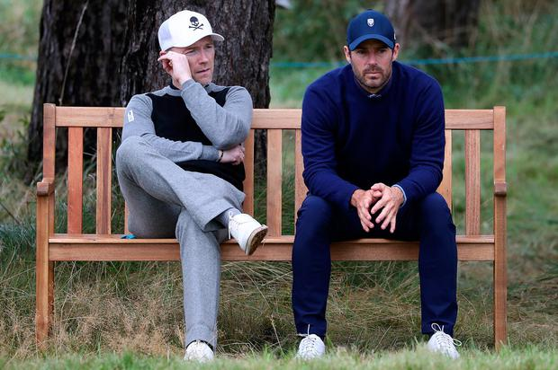 Ronan Keating and Jamie Redknapp take a break on the 10th tee during day one of the Alfred Dunhill Links Championship at Carnoustie yesterday. Photo: PA