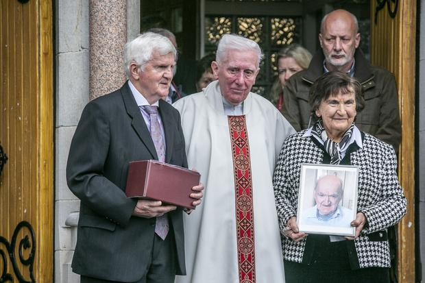 Brian Boylan (only friend of Joseph ) and Margaret Browne (organiser) and Fr Dennis Kennedy carrying the remains of Joseph Tuohy from St Josephs Church Glasthule after his funeral