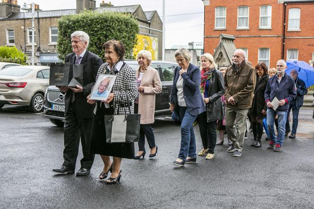 Brian Boylan (only friend of Joseph ) and Margaret Browne (organiser) carrying the remains of Joseph Tuohy in to St Josephs Church Glasthule for his funeral