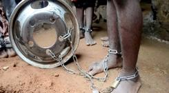People with chained legs are pictured after being rescued from a building in the northern city of Kaduna, Nigeria September 26, 2019, in this grab obtained from a video.