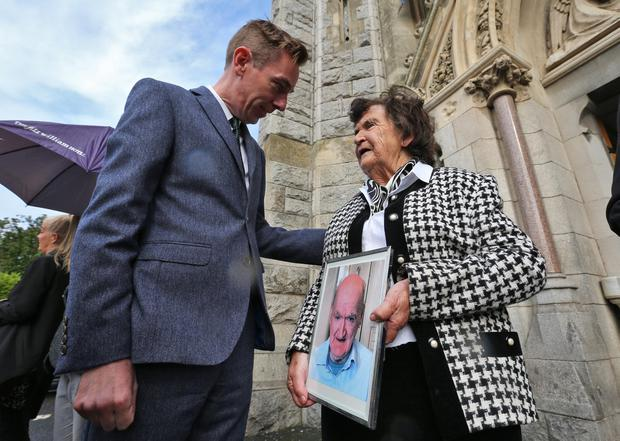 Sad: RTÉ's Ryan Tubridy with Margaret De Brun of Friends of the Forgotten Irish at the funeral of Joseph Tuohy in Glasthule. Photo: Colin Keegan/Collins