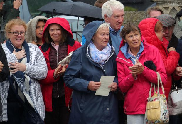 Ceremony: Mourners at the funeral of Tuohy in Glasthule, Dublin, yesterday. Photo: Colin Keegan/Collins