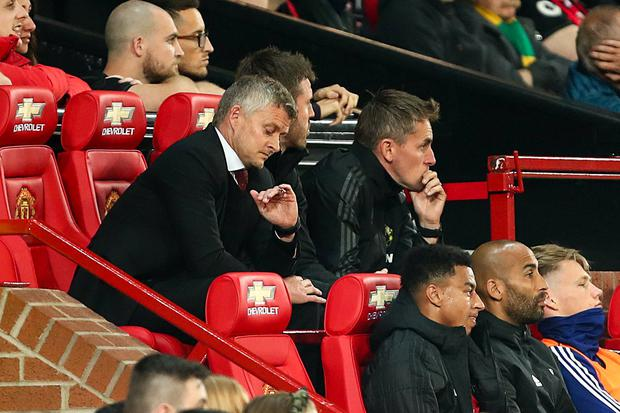Time running out: Ole Gunnar Solskjaer looks at his watch during Manchester United's League Cup clash against Rochdale on Tuesday. Photo: Robbie Jay Barratt - AMA/Getty Images