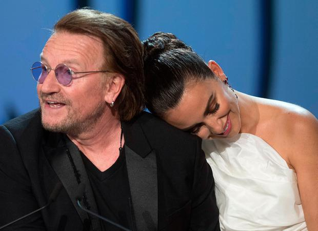 Actress Penelope Cruz receives a Donostia Award for her career from U2 singer Bono at the 67th San Sebastian Film Festival in Spain last night. Photo: ANDER GILLENEA/AFP/Getty Images