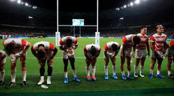 Japan players bow to their supporters after victory during the 2019 Rugby World Cup match at the Shizoka Stadium Ecopa, Shizouka Prefecture, Japan. Photo credit: Adam Davy/PA Wire.
