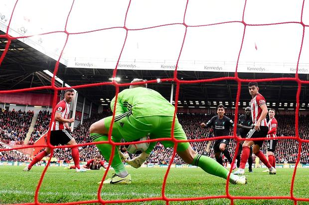Dean Henderson of Sheffield United fails to saves Georginio Wijnaldum's (obscured) shot which lead to Liverpool's winning goal during the Premier League match at Bramall Lane. Photo: Laurence Griffiths/Getty Images