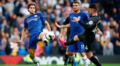 Marcos Alonso of Chelsea battles for possession with Aaron Connolly of Brighton during the Premier League match at Stamford Bridge. on September 28, 2019 in London, United Kingdom. Photo: Julian Finney/Getty Images