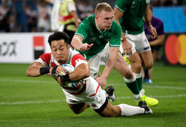 Japan's Kenki Fukuoka scores a try. Photo: Jae Hong/AP Photo