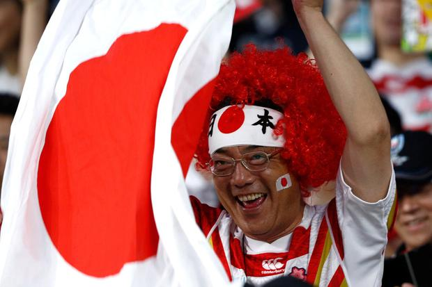 A Japanese fan cheering during the match. Photo: Edgar Su/Reuters