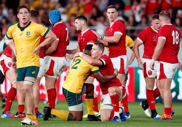 Rugby Union - RugbyWorldCup2019 - Pool D - Australia v Wales - Tokyo Stadium, Tokyo, Japan - September 29, 2019 Wales and Australia players other after the match REUTERS/Issei Kato