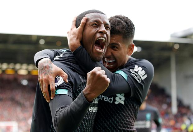 Soccer Football - Premier League - Sheffield United v Liverpool - Bramall Lane, Sheffield, Britain - September 28, 2019 Liverpool's Georginio Wijnaldum celebrates scoring their winning goal with Roberto Firmino REUTERS/Phil Noble
