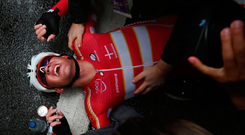 Denmark's Mads Pedersen collapses to the ground after crossing the finish line to win in the men's road race World Championship in Harrogate. Photo: BEN STANSALL/AFP/Getty Images