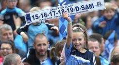 A young fan celebrates the men's five-in-a-row. Photo: Damien Eagers / INM