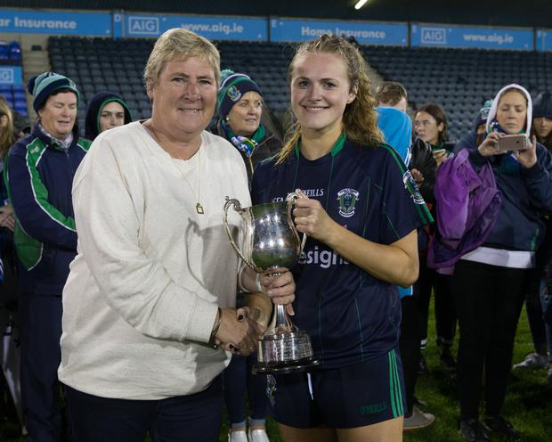 Patsy Hetherton presents Foxrock Cabinteely's captain Amy Connolly with the Dublin SF Championship Cup. Picture: GAApics.com