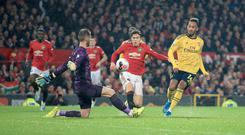 Arsenal's Pierre-Emerick Aubameyang chips the ball past Manchester United goalkeeper David de Gea to score the equaliser at Old Trafford. Photo: Simon Stacpoole/Offside/Offside via Getty Images