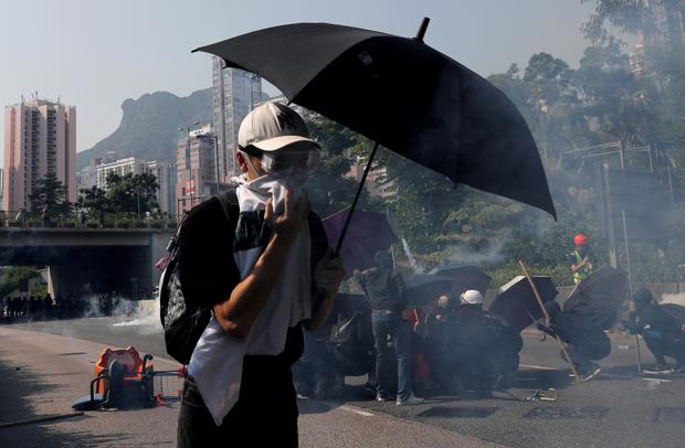 An anti-government protester runs from tear gas during a protest on China's National Day, in Wong Tai Sin, Hong Kong, China October 1, 2019. Picture: REUTERS/Tyrone Siu