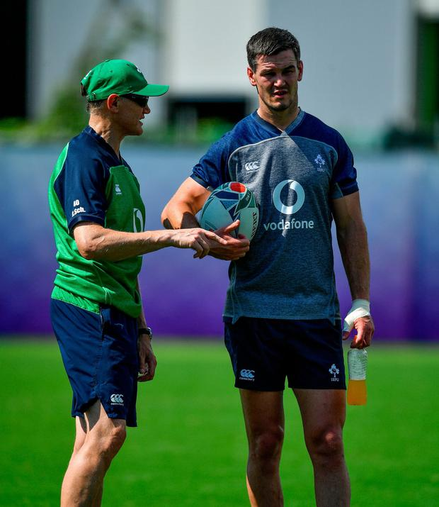 Joe Schmidt, left, and Jonathan Sexton in conversation during Ireland Rugby squad training at the Kobelco Steelers in Kobe, Japan