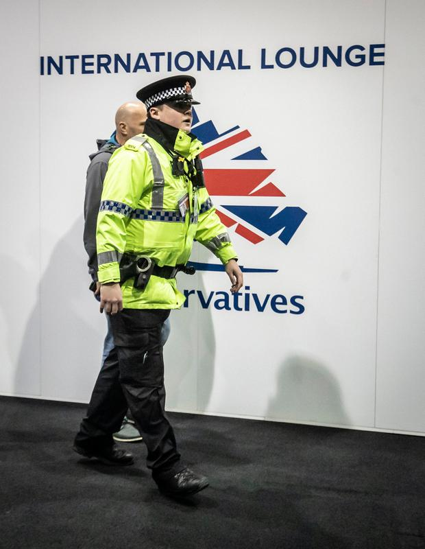 Police arrive at the Conservative Party Conference after a