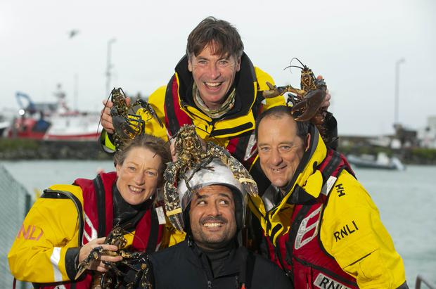Ship shape: Howth RNLI lifeboat crew Fin Goggin, Ian Sheridan and coxswain Fred Connolly, are joined by Dublin restaurateur Niall Sabongi. Picture: Patrick Browne