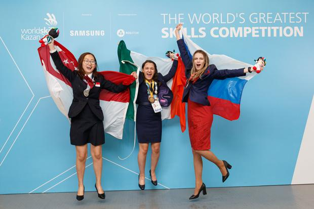 Megan Yeates (centre) celebrating her win with the runners up. Photo: Himal Reece
