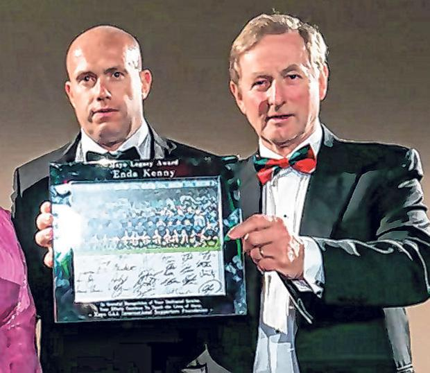 Tim O'Leary with former Taoiseach Enda Kenny at the county's gala ball in the city