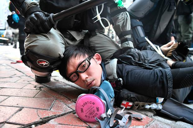A protester is arrested by police