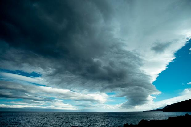 Heavy clouds are seen above the sea, in Sao Roque do Pico, on the Pico Island, on October 1, 2019 as Hurricane Lorenzo passes over the Portuguese archipelago of the Azores. Photo by Lino BORGES / AFP