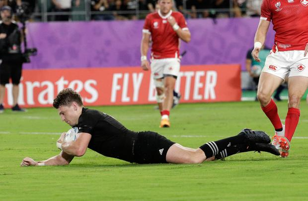 New Zealand's Beauden Barrett scores a try during the Rugby World Cup Pool B game at Oita Stadium between New Zealand and Canada in Oita, Japan, Wednesday, Oct. 2, 2019. (AP Photo/Aaron Favila)