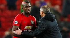 Manchester United manager Ole Gunnar Solskjaer shakes hands with Paul Pogba at the end of the 1-1 Premier League draw with Arsenal last Monday