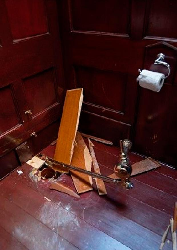 Damage to the stall from which a golden toilet that was stolen at Blenheim Palace Photo credit: Thames Valley Police/PA Wire