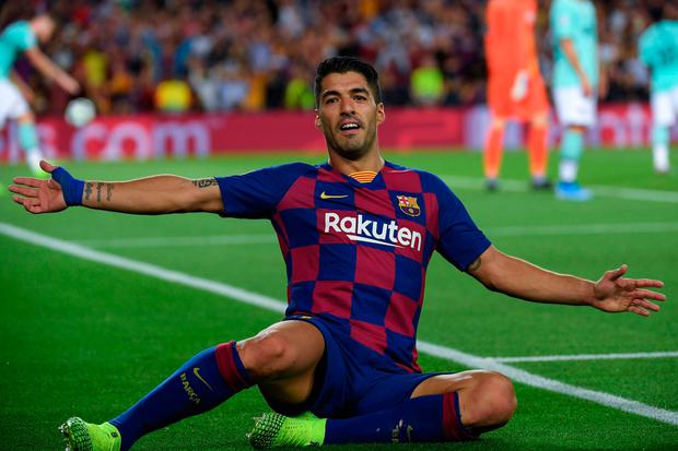Barcelona's Luis Suarez celebrates scoring the winner in the Champions League Group F clash with Inter Milan at the Nou Camp