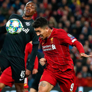 Liverpool's Roberto Firmino wins the ball ahead of Enock Mwepu of Salzburg. Photo: Getty Images