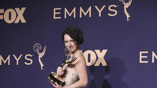 Phoebe Waller-Bridge refuses to put down her newly won Emmy Awards in a teaser for her Saturday Night Live hosting debut (Jordan Strauss/Invision/AP)