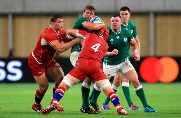Ireland's Jordi Murphy is tackled by Russia's Andrey Garbuzov