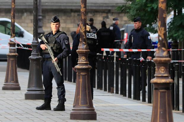 Police officers control the perimeter outside the Paris police headquarters, Thursday, Oct.3, 2019 in Paris. (AP Photo/Michel Euler)