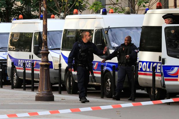 Police officers control an area outside the Paris police headquarters, Thursday, Oct.3, 2019 in Paris. (AP Photo/Michel Euler)