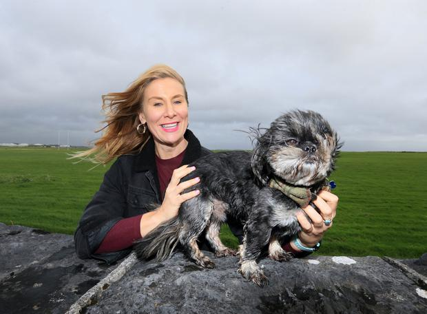 Lisa Regan pictured with her Shih Tzu Malteese cross, Toby during their walk at the Claddagh in Galway as storm Lorenzo tracked up the west coast of Ireland.Picture Credit:Frank McGrath