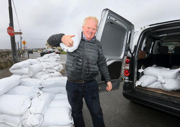 Padraic Conroy from Galway collects some sandbags at the Claddagh as storm Lorenzo tracked up the west coast of Ireland.Picture Credit:Frank McGrath