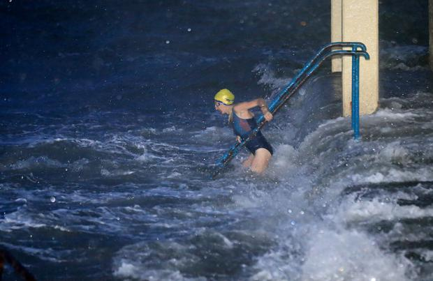A sea swimmer takes to the water at the Blackrock Diving tower near the Promenade in Galway as storm Lorenzo tracked up the west coast of Ireland.Picture Credit:Frank McGrath