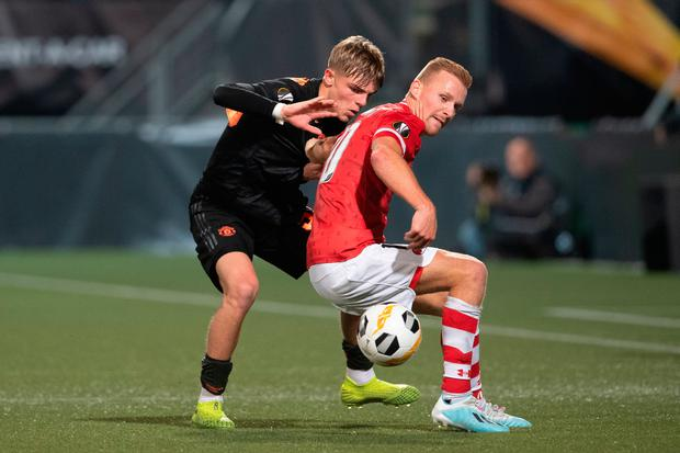 Manchester United's Brandon Williams (left) in action during the Europa League Group L draw with AZ Alkmaar