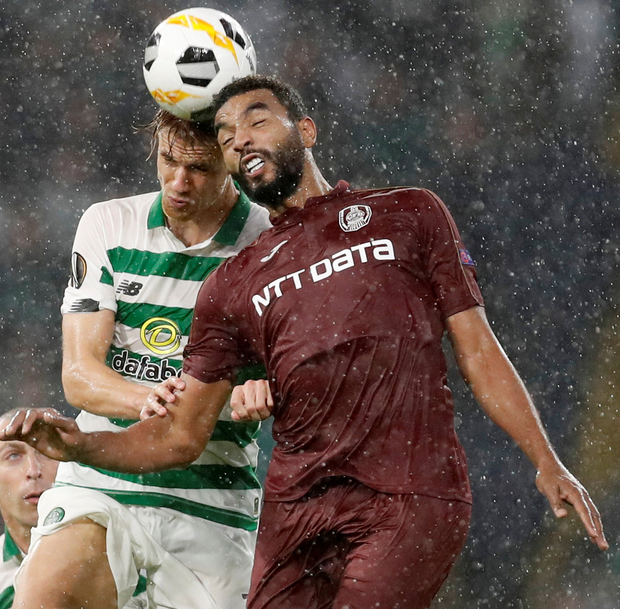 Celtic's Kristoffer Ajer rises for the ball with CFR Cluj's Billel Omrani. Photo: Reuters