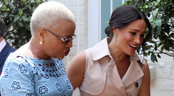 Welcome: Meghan Markle meets Graca Machel, widow of the late Nelson Mandela during the royal couple's tour of South Africa. Photo: REUTERS/Chris Jackson