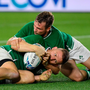 Andrew Conway is congratulated by Jack Carty after scoring Ireland's fourth try