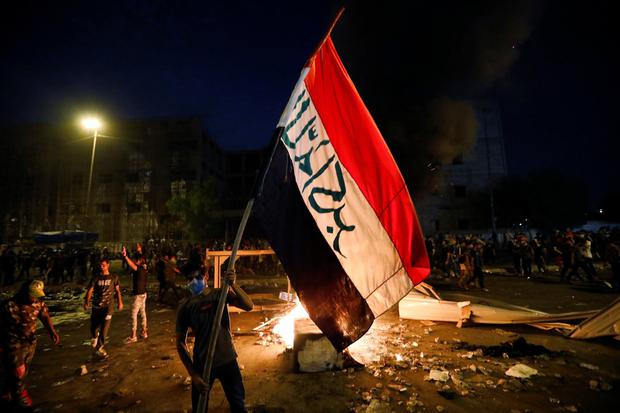 Demonstrators gather at a protest during a curfew, two days after the nationwide anti-government protests turned violent, in Baghdad. Photo: REUTERS/Thaier Al-Sudani