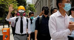 Anti-government office workers wearing masks attend a lunch time protest REUTERS/Tyrone Siu
