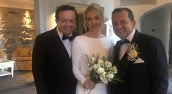Marty Morrissey cosies up to newly-weds Davy and Sharon (Photo: Twitter/Marty Morrissey)