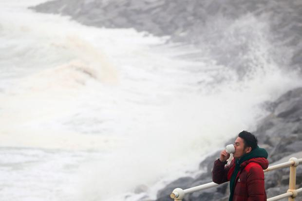 Waves crash on the seafront at Lahinch, Co Clare. Picture: PA