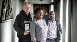 United stand: Cormac McAleer from Tyrone, Mina Beyan from Liberia and Emmanuel Peni of Papua New Guinea at the Front Line Defenders conference in Dublin Castle. Photo: Kyran O'Brien