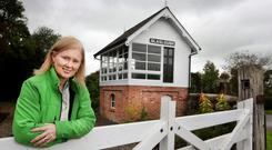 Vibrant community: Louise Duffy, co-ordinator of Glaslough Tidy Towns, in front of the rebuilt railway station signal box